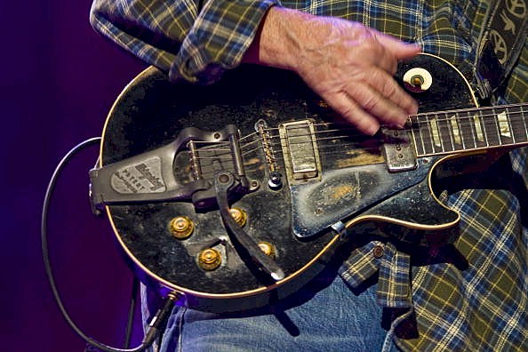 Neil Young playing guitar